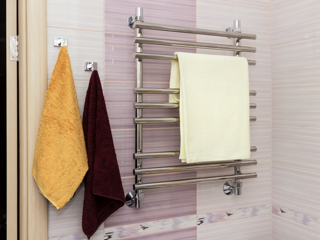 Towels hanging on a rack and hooks