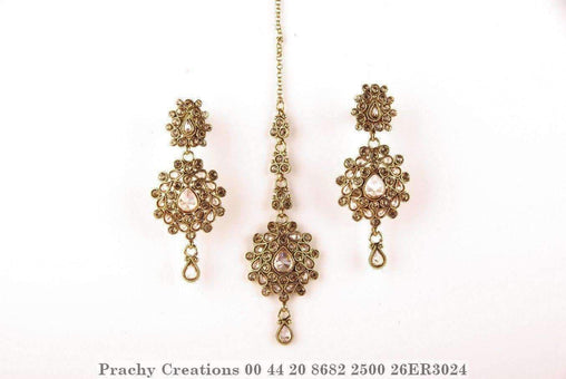 Prachy Creations : Antique gold finish tika with matching earrings 26ER3024