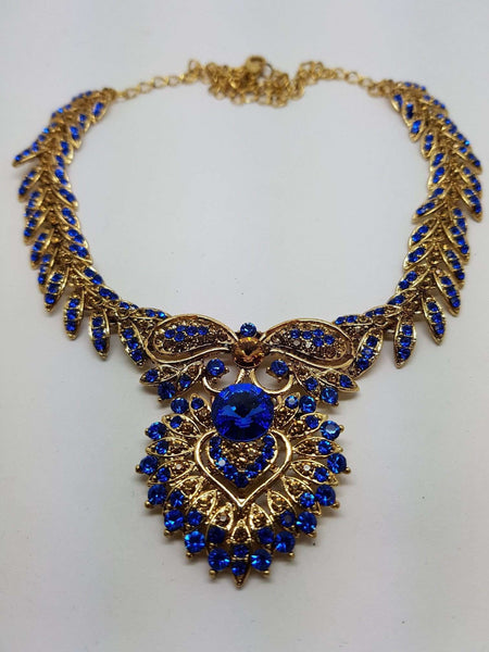 Prachy Creations : DC76267BLU KA - Antique gold finish Blue Necklace, Earrings and Tika set