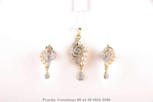 Prachy Creations : Stunning pendant with matching earrings 565-120