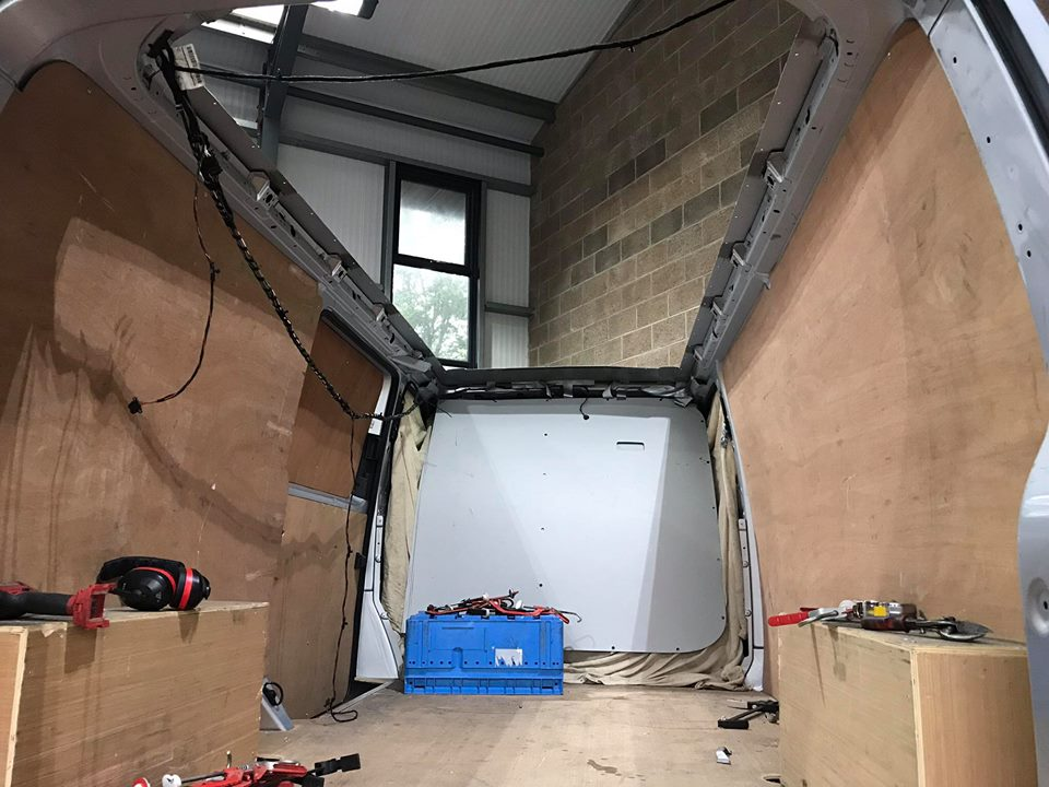 Removing the ply from a VW T6 Panel Van ready to convert it