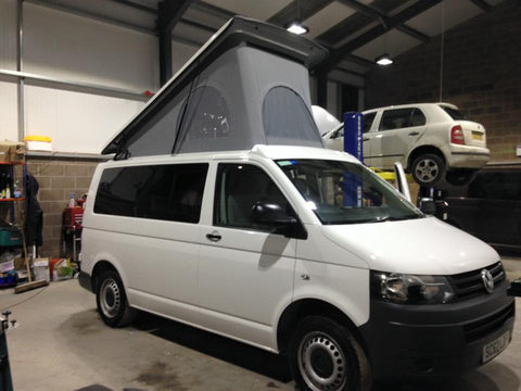 Volkswagen camper van with a material extending roof