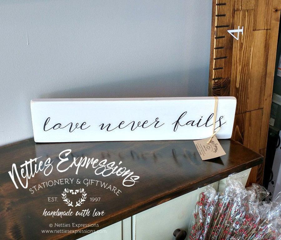 Love never fails - Rustic Wood Sign - Netties Expressions