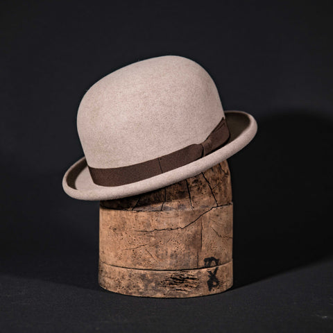Custom open crown hat in natural with brown ribbon