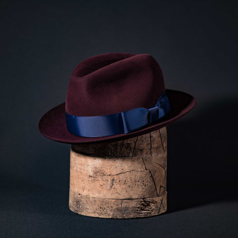 Custom Centre dent fedora hat in black cherry with navy ribbon