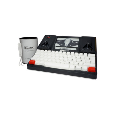 white custom keys on Freewrite with puller and container
