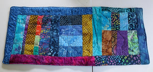 Bright and colorful quilted reversible table runner insulated bohemian patchwork many beautiful batiks fabric