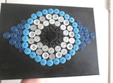 Evil eye button art work with vintage buttons on canvas