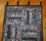 Black batik wall hanging with splashes of color one of a kind quilted wall hanging