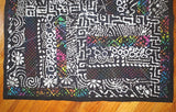 black and colorful batik quilted