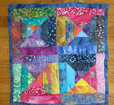 Batik quilted wall hanging many pretty bright batiks one of a kind