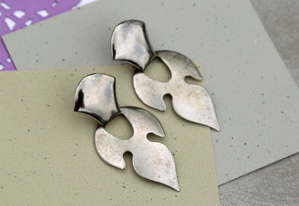 Vintage silver toned flame earrings