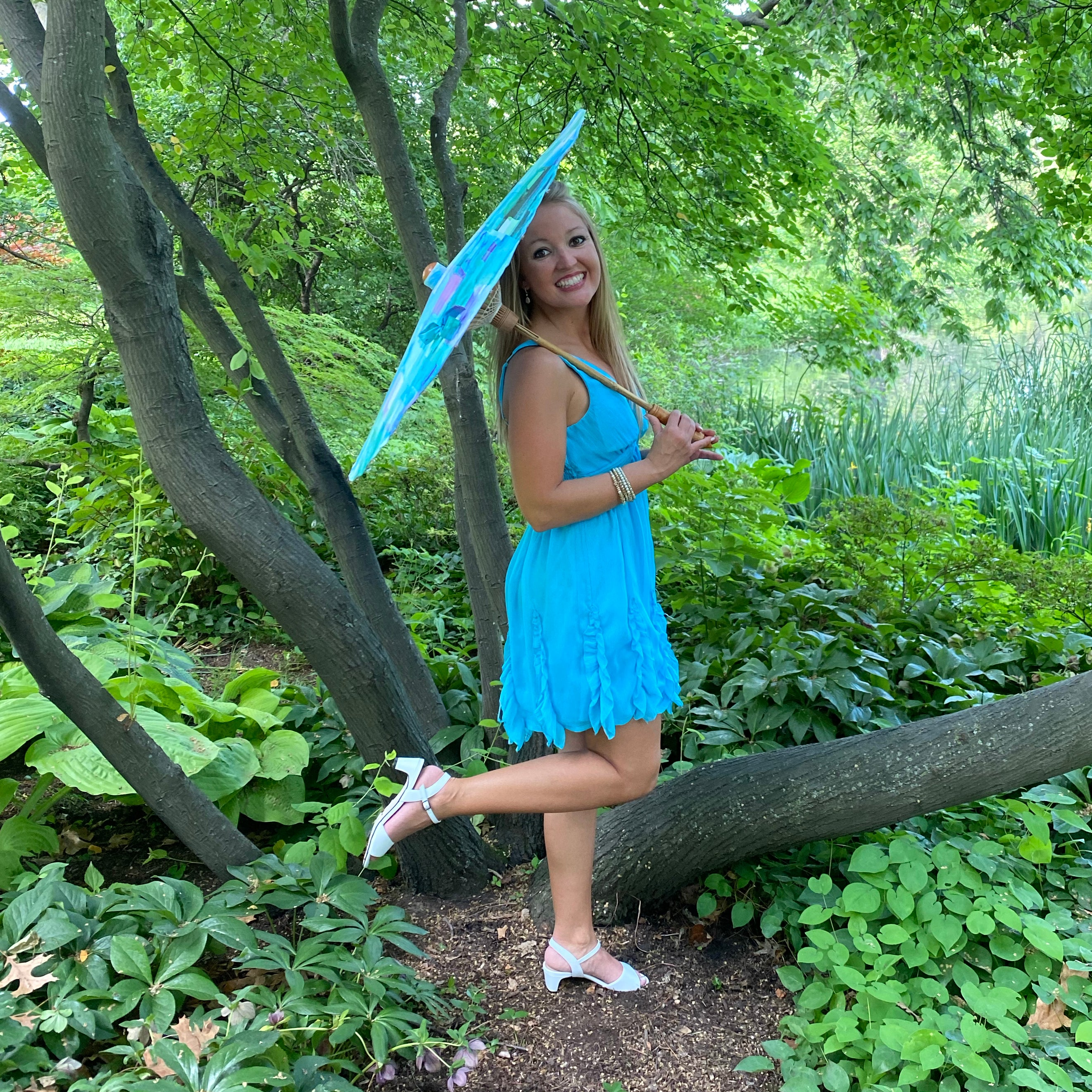 Bethany wearing the Lydia sandal in white leather. Parasol by Lily Lark.