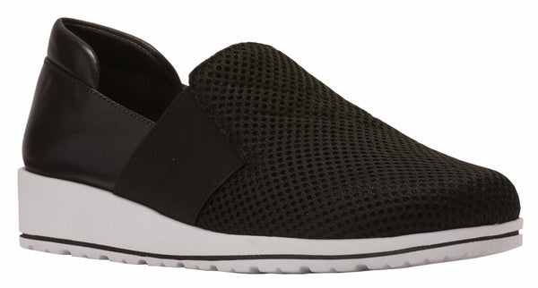 Image of the Fraley. The Fraley is a comfortable and fashionable athletic inspired casual slip-on shoe that is styled in black fabric and black leather. The bottom is a lightweight and flexible material with a small lift in the heel. The color of the bottom is white with a thin black strip.