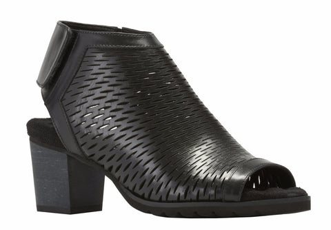 Image of the Nikki. The Nikki is a comfortable and fashionable, open toe bootie that is styled in a black accordion leather.
