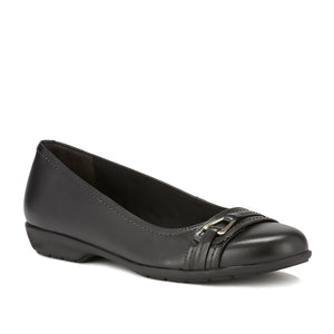 Image of the Flynn. A comfortable black leather slip on shoe with a low heel and a small buckle detail on the toe.  Available in narrow width, wide width and extra wide widths.
