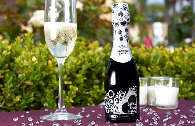 Find the most creative wedding favors. Use mini champagne bottles for your champagne toast. Include your wedding theme colors in your bottle designs.