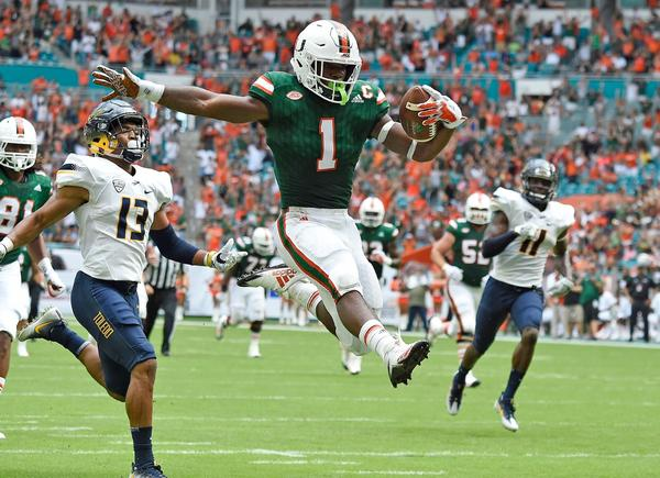 Mark Walton Signed Photo - Leaping Endzone