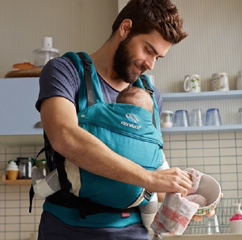babywearing new baby in a manduca baby carrier