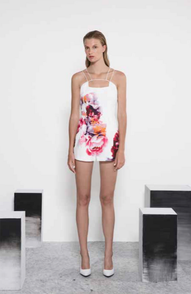 White playsuit featuring an autumn coloured flower print
