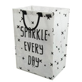 Minene white and black laundry hamper for nurseries, bathrooms and outdoor toy storage