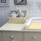 yellow storage box for changing tables and use in cupboards