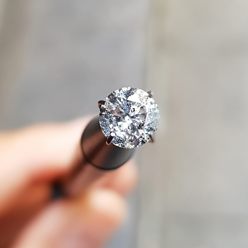 Salt and pepper diamonds are popular in engagement rings