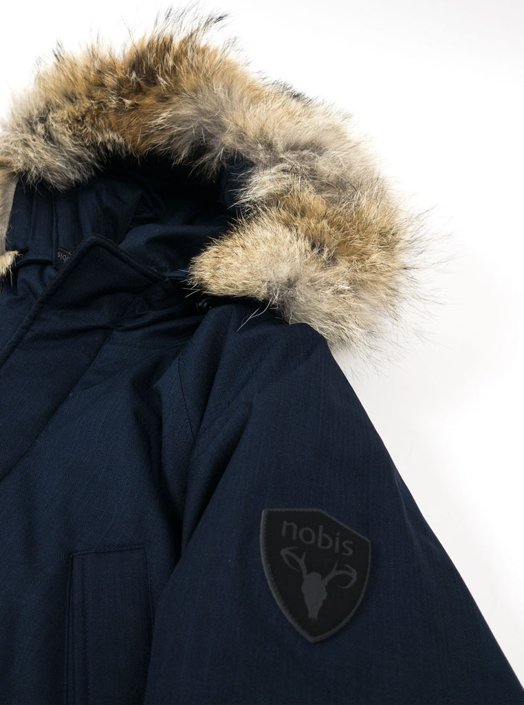 "alt=""Nobis-Heritage-Down-parka-navy-Northern-fells-logo"""
