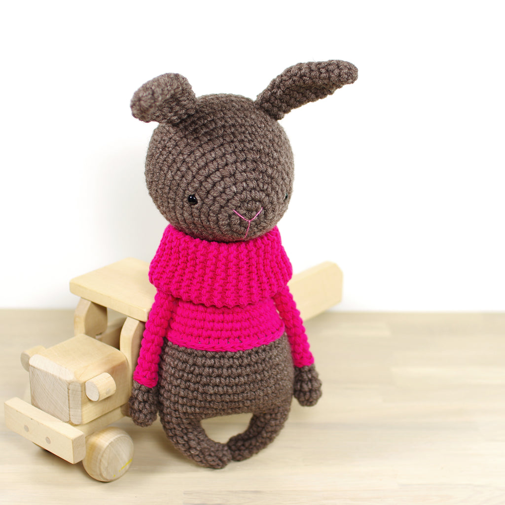 Bunny in a Bright Pink Sweater