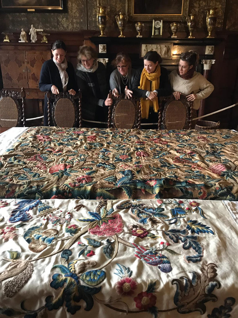 The team viewing the original Muncaster Bed Hanging with the replica