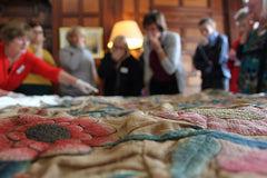 Group at Muncaster Castle viewing the textile collection