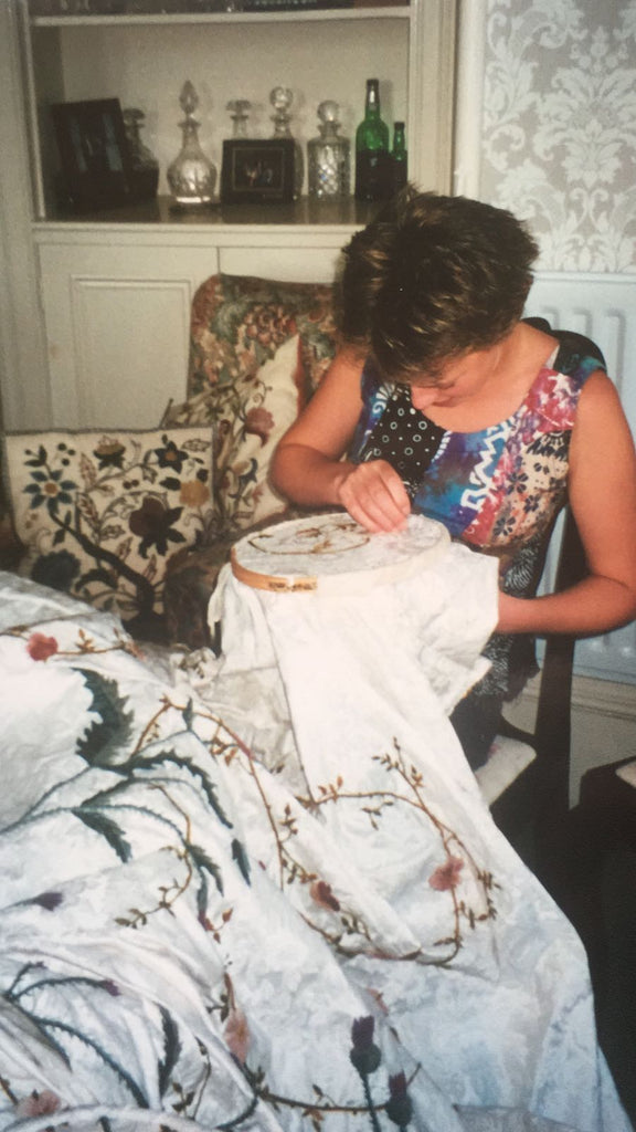 Laura, aged 16, putting some stitches in the Queen Mother's Bedspread