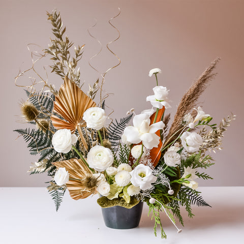Festive white and green floral arrangement with pop of gold