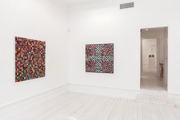 From Left: Alighiero Boetti, Untitled, 1989, Embroidery, 44.875 x 40.9375 inches (114 x 104 cm); Alighiero Boetti, Untitled, 1988, Embroidery, 42 x 43.75 inches (107 x 111 cm).