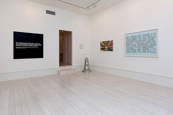 From Left: Joseph Kosuth, Andy Warhol quote, 1968, Mounted photograph, 48 x 48 inches, (121.92 x121.92 cm); Paul McCarthy, Stainless Steel Butt Plug, 2007, Polished stainless steel, 35 x 22 x 16 inches, (88.9 x 55.9 x 40.6 cm); Roy Lichtenstein, Sunrise, 1965, Porcelain enamel on steel, 22.5 x 36 inches, (57.2 x 91.4 cm); Richard Prince, My Wife, My Wife, 2004, Cancelled checks and acrylic on canvas, 35.5 x 48 inches (90 x 120 cm)