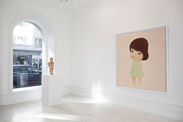 From Left: Claudette Schreuders, The Insider, 2009, Lime wood and enamel paint, 22.5 x 9 x 8.625 inches (57.15 x 23 x 22 cm) (image courtesy of the artist); Yoshitomo Nara, Missing in Action, 2000, Acrylic on canvas, 65 x 58.5 inches (165 x 149 cm)