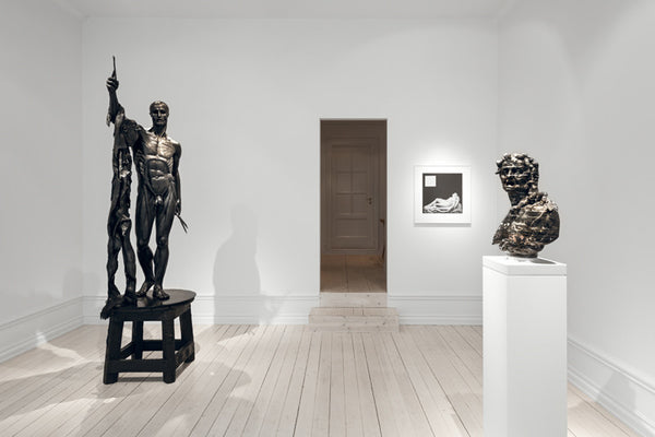 From Left: Damien Hirst, Saint Bartholomew, Exquisite Pain, 2006, bronze, 98.4 x 43.3 x 37.4 in (250 x 110 x 95 cm); Robert Mapplethorpe, Sleeping Cupid, 1989, Gelatin Silver Print, 24 x 20 in. (60.96 x 50.8 cm); Barry X Ball, Envy, 2008 – 2016, Italian Portoro Marble and stainless steel, 22 x 17 1/4 x 9 1/2 in. (55.9 x 43.8 x 24.1 cm), pedestal assembly: Macedonian Marble, stainless steel, wood, acrylic lacquer, steel, nylon, plastic, 46 x 14 x 12 in. (116.8 x 35.6 x 30.5 cm)