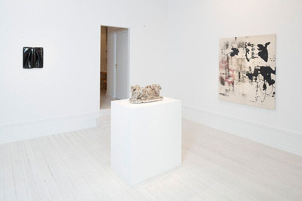 Left to right: Daniel Turner, 5150 (1/10/12), 2012, bitumen emulsion, vinyl and wood, 16.5 x 14 x 1.5 in (41.9 x 35.56 x 3.81 cm); Rosemarie Trockel, Not Yet Titled, 2007, ceramic and platinum glaze, 11.13 x 22.5 x 10.25 in (28 x 57 x 26 cm); Nate Lowman, Open Container, 2012, resin, red wine, dirt, spray paint and polymer on canvas, 60 x 47 in (142.2 x 119.4 cm)