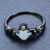 10KT Black Gold Filled Elegant Heart Cut Rainbow Fire Opal Claddagh Genuine White Sapphire placed just above the Rainbow Opal Promise Ring - Victoria Vault