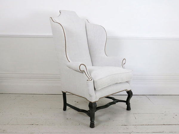 A magnificent, rare and very large early 18th Century Queen Ann wing chair