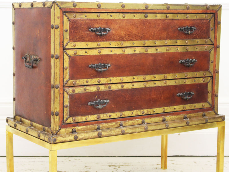 A 1930's French Leather Travelling Chest of Drawers on Brass Stand
