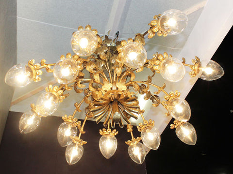 A 1950's magnificent, Spanish 16 arm gold toleware chandelier