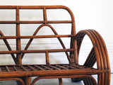 A beautiful 1950's pretzel rattan sofa possibly by Paul Frankl