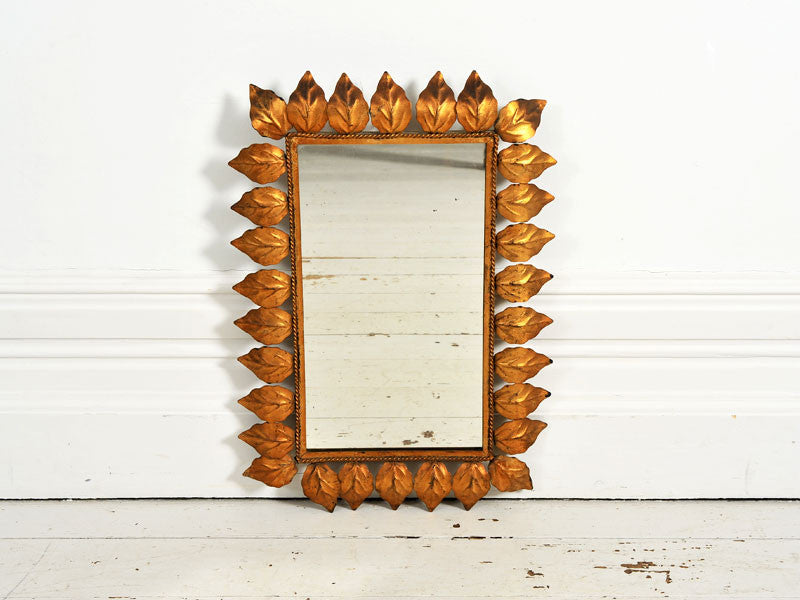 A 1950's French Rectangular mirror with gold metal leaf surround