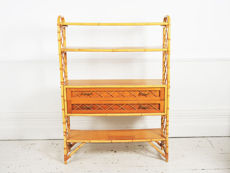 A 1950's French bamboo & rattan shelf unit with two drawers