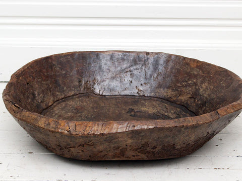 An exceptionally large antique burr elm bowl carved from one piece of wood