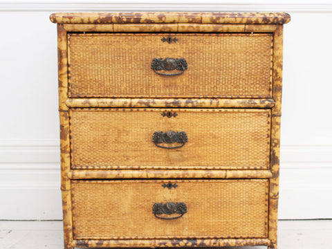 A late 19th Century three drawer bamboo & wicker commode