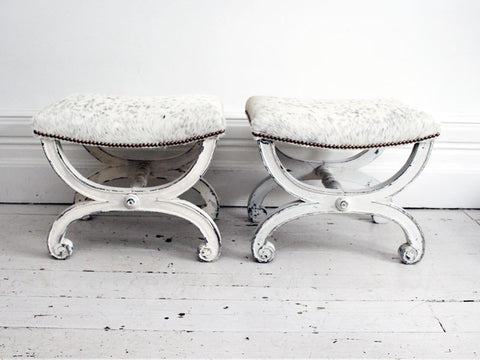 19th C pair of white painted scroll legged stools upholstered in cowhide
