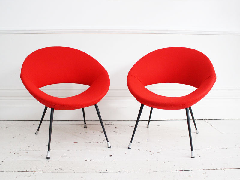 A pair of Italian 1950's round metal-framed red chairs in the style of Augusto Bozzi