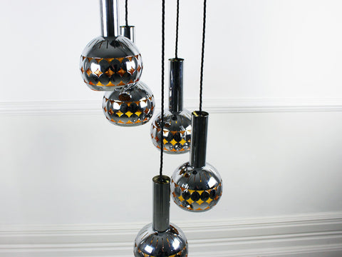 Five headed steel ceiling light with amber lining